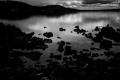 You find your eyes are growing moist (.KiLTЯo.) Tags: kiltro cl chile lagoblanco magallanes tierradelfuego patagonia longexposure water lake rocks contrast nature landscape bw blackandwhite clouds