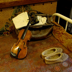 Gillette's Bed (Coyoty) Tags: gillettecastle gillettecastlestatepark easthaddam connecticut ct statepark park castle building historic museum williamgillette sherlockholmes actor theater theatre violin music musical musicalinstrument slippers footwear linen bedspread bed bedroom binoculars suitcase crimson red grass decoration decor squareformat square newengland fiddle