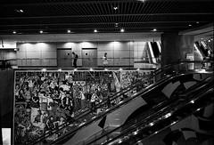 Singapore MRT station (Thanathip Moolvong) Tags: epson v800 nikon s3 ilford delta 400 2 bw film singapore mrt station travel life commuter
