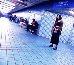The Key That Hangs Around Your Neck (kirstiecat) Tags: philly philadelphia america pennsylvania subway underground woman strenger female human alone lonely key necklace blue color colour canon style streetstyle
