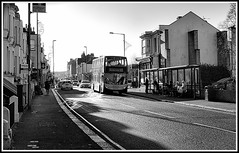 The views I like as I stroll into town 2. (tony allan tony allan) Tags: street streetphotography streetlife busstop road bus architecture mono monochrome blackandwhite blackwhite m42 manualfocus legacyglass lens urbanperspectives urban urbanlife canoneos100d meyeroptiklydith30mmlens