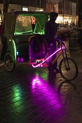 Waiting (millwall.rl) Tags: bike london night transportation person green purple reflections pavement shops