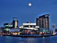 The Lowry complex and the Moon (Tony Worrall) Tags: gmr manchester manc city northwest welovethenorth nw north update place location uk visit area attraction open stream tour photohour photooftheday pics country item greatbritain britain british gb capture buy stock sell sale outside dailyphoto outdoors caught photo shoot shot picture captured ilobsterit instragram england salford salfordquays wet water river weather scene lowry scenery architecture building modern