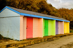 Colourful huts (wells117) Tags: folkstone uk beachhuts bright building changingrooms clouds cloudy colour colourful daytime doors four huts kent manmade nopeople outdoors outside painted path pathway pavement roof shelters sky step structure trees