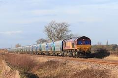 DB Cargo (EWS) 66194 Drax Biomass Hoppers 11th December 2019 Mauds Bridge (1) (asdofdsa) Tags: maudsbridge railway trains locomotive dbcargo drax sky trackside