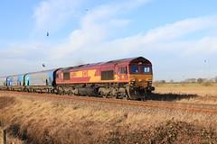 DB Cargo (EWS) 66194 Drax Biomass Hoppers 11th December 2019 Mauds Bridge (3) (asdofdsa) Tags: maudsbridge railway trains locomotive dbcargo drax sky trackside birds meadowpipit