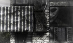 Face Front (Loegan Magic) Tags: secondlife architecture storestorefront blackandwhite monochrome brick joker thejoker awning window urban