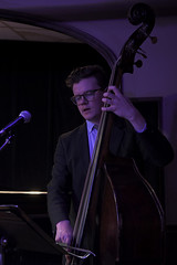 Bass Player (Anthony Mark Images) Tags: bass doublebass bassplayer bow mocrophone musicstand concert suit stage thejazzroom jazzmusic jazz male glasses band emiliecalirebarlow people portrait huetherhotel waterloo ontario canada nikon d850 flickrclickx