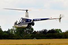 G-BTBA  Halfpenny Green  02-07-2011 (Joseph Collinson) Tags: halfpennygreen wolverhampton helicopter landing midlands robinsonr22 july 2011 summer