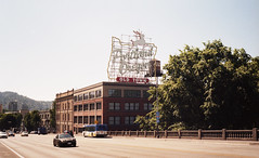 Portland, OR (neilsonabeel) Tags: olympustrip35 olympus zuiko 40mm portland oregon pdx sign burnsidebridge film analogue car bridge pacificnorthwest zonefocus road street burnside