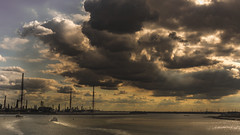 """Storm chasers (mandyhedley) Tags: cranes industry industrial sunrays rain ferry antwerp river stormclouds clouds """"flickrtravelaward"""""""