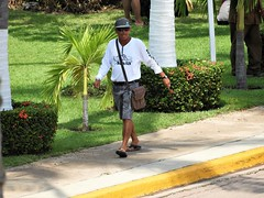Man on a Mission (knightbefore_99) Tags: mexico mexican rincon guayabitos west coast tropical nayarit sunny sun sol candid awesome cool hombre mission hurry suspicious cap ned