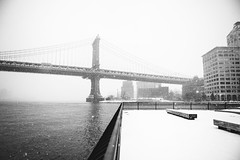 The Salty Water and Crystalline Snow (Airicsson) Tags: snow street urban nyc newyork city white winter cold snowstorm america usa cityscape storm brooklyn manhattan bridge eastriver bank dumbo