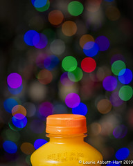 """20191211  Best By Jan 17 33798-Edit (Laurie2123) Tags: christmasbokeh laurieabbotthartphotography laurieturner laurieturnerphotography laurietakespics laurie2123 nikond800e odc odc2019 ourdailychallenge bokeh nikkor60mm """"orange juice""""expirationdate offcameraflash """"godox ad200"""