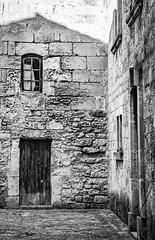 Feeling Cornered (Katrina Wright) Tags: lesbauxdeprovence dsc6936edit bw nb village stone stonehouses windows derelict abandoned door hww windowwednesday wallwednesday brickwall street culdesac monochrome hmbt thursday