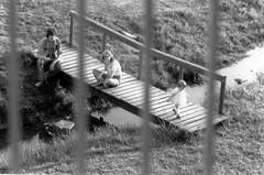Day's End (BrilliantBill) Tags: time monochrome blackandwhite film family bridge child pennsylvania stream verticals street history