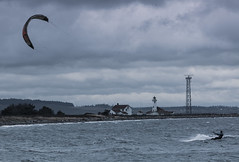 5IMG4229 kiteboarder (Glenn Gilbert) Tags: porttownsend pugetsound washington fortworden kiteboarder kiteboarding recreation lighthouse pointwilson pacificnorthwest sport canon bay beach coast overcast cloudy waves gusty windy