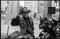 Easy Rider (waex99) Tags: blue portrait homme man senior bike biker velo cycle leica m6 film analog argentique kodak trix 400iso summicron 50mm singapore singapour river bridge leather cuir salut salute black white noir blanc bw nb monochrome telemetrique rangefinder cavenagh fake fun faux drole