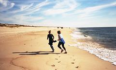 Egypt Beach, East Hampton - September 2015 (neilsonabeel) Tags: olympustrip35 olympus zuiko 40mm film analogue beach easthampton longisland newyork suffolkcounty runner water sand