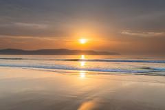 Golden Hour Hazy Sunrise Seascape (Merrillie) Tags: daybreak sunrise smokehaze haze nature dawn australia water centralcoast morning sea newsouthwales waves uminabeach nsw waterscape beach ocean earlymorning landscape cloudy coastal clouds sky seascape smoky coast outdoors seaside