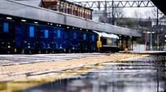 Focus on the weather (Peter Leigh50) Tags: rain wet weather platform reflections station stockport building fujifilm fuji freight freightliner shed class 66 november train track railway railroad rail xt2