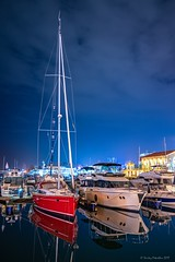 Ships in the harbor in the summer night (Berilyon) Tags: sea night yacht red big travel background reflection boat bay black blacksea coast europe evening landmark landscape light natural nature ocean sail sailboat ship sky sochi summer tourism vacation water expensive