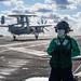 Aviation Boatswain's Mate (Equipment) 1st Class Yaovi Ameto supervises an arresting gear team aboard USS John C. Stennis (CVN 74).
