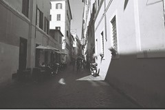 Roma (goodfella2459) Tags: nikonf4 afnikkor24mmf28dlens ilforddelta100 35mm blackandwhite film analog city streets road buildings roma italy rome bwfp