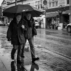 Lee Lane (IWCharters) Tags: street umbrella mono bolton horwich rain england lancashire