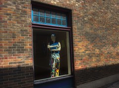 (Plane Sight Images) Tags: outdoors wall bricks window mannequin color streetphotography