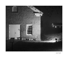 Spotlight (agianelo) Tags: east ward school house stone doors window bench night monochrome bw bn blackandwhite