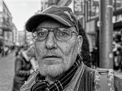 LIVING ON THE STREET (NorbertPeter) Tags: man street people portrait spontaneous düsseldorf germany homeless poverty city urban outdoor cap beard streetphotography streetportrait monochrome panasonic lx100ii blackandwhite bw