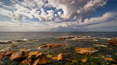 Gulf of Finland (中村巌) Tags: sea shore stones island clouds baltic summer море берег побережье камни облака балтика лето 海 岩 石 雲 空 sky nikon d5300 wide