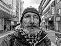 PORTRAIT OF A HOMELESS MAN (NorbertPeter) Tags: man street people düsseldorf germany portrait spontaneous city urban outdoor beard homeless poverty streetphotography streetportrait panasonic lx100ii monochrome blackandwhite bw face