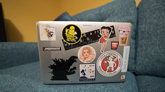 Sticks (Stray Toaster) Tags: home front room macbook laptop stickers godzilla gaia little creatures gnu dinky doors betty boop toastface grillah