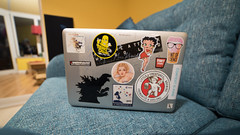 Less empty room (Stray Toaster) Tags: home front room macbook laptop stickers godzilla gaia little creatures gnu dinky doors betty boop toastface grillah