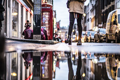 Legs looking lively in London (Paul wrights reserved) Tags: soho london londonstreets streetphotography street streetlights bokeh bokehphotography bokehballs reflection reflections reflectionphotography phonebox londonphonebox red redphonebox