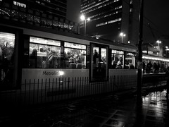 Inside out (dereksalisbury68) Tags: manchesterstreetphotography manchester streetphotography blackwhitephotography blackwhite water rain silhouette people wet reflection lightflare metrolink tram crowd