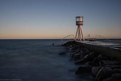 Yes, that pier again (katrin glaesmann) Tags: copenhagen klampenborg bellevuebeach denmark onthebeach baywatch sunset bench leading lines longexposure arnejacobsen lifeguardtower 1930s