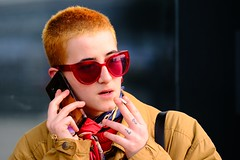 ** (donvucl) Tags: london granarysquare woman candidportrait candid orange yellows phone glasses portrait fujixt3 colour donvucl