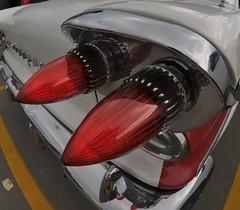 1958 Pontiac tail light, Toronto Queensway (edk7) Tags: nikond300 bowerae8mm135fisheyecsfisheyelens edk7 2013 canada ontario toronto etobicoke queensway car vehicle automobile auto classic vintage 1958pontiac taillight rearlight
