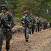 U.S. Marines conduct a patrol during part of a comprehensive force on force event at Forest Light Middle Army