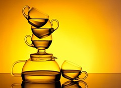 Tea for You and Me (Karen_Chappell) Tags: tea teapot teacup balance orange yellow glass stilllife liquid beverage drink reflection stack color colour