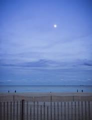 moon over manasquan (postcards from the beach #1) (Steve Stanger) Tags: olympus olympusomdem10markii microfourthirds m43 micro43 getolympus olympuscamera manasquan beach sunset moon moonrise sand shore coast horizon fence stormfence ocean njshore nj seascape shoreline fishing
