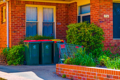 At Number 79 (Erich Schieber) Tags: shoppingtrolley house architecture suburbia shoppingcart australia rubbishbin ottobin orange