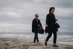 Along The Coast (Stefan Waldeck) Tags: women smoking cigarette sunglasses bags handbags shoes waves water sky clouds theatlanticsea portugal 2019 netzki stefanwaldeck stefan waldeck