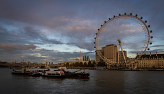 Early evening on The Embankment (cliveg004) Tags: theeye westminster southbank countyhall cityoflondon riverthames london city clouds sunset dusk evening hungerfordbridge bridges boats nikon d7500