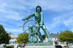 Gloucester Fisherman's Memorial (a.k.a. Man at the Wheel) located near the entrance of Gloucester, Massachusetts, USA. (forestproperties) Tags: blue building architecture bay atlantic american ann cape attraction city man history coast harbor fisherman guidance cove landmark historic east gloucester historical coastline eastern ocean old sea monument rock point marine memorial state massachusetts shore maritime nautical seashore navigation york travel usa tourism wheel town tour village united unitedstatesofamerica