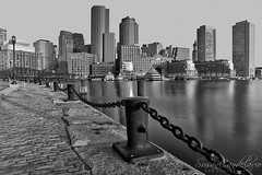 Boston Skyline New Day BW (Susan Candelario) Tags: bluesky boston cityscapes newengland oldnorthernbridge places susancandelario architecture beantown bluehour boat boats bostonharbor bostonskyline ceremony cities cityscape dawn evening fanpier harborwalk highrises land marina mass massachusetts night nighttime odyssey pier piers roweswharf scenery skies sky skyline skylines skyscraper sundown sunset sunsets transport transportation twilight uswater water watertransportation watercraft waterfront yacht yachts