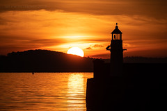 Sunburst Finish (ianrwmccracken) Tags: horizon lighthouse d750 nikon sunset sigma reflection sundown orange light fife silhouette cloud 150600mmf563c afternoon riverforth burntisland scotland coast ripple sea